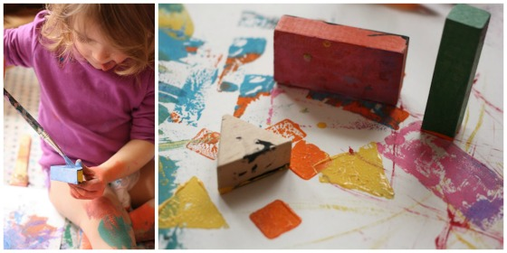 toddler painting with blocks