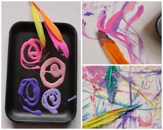 toddler painting with feathers