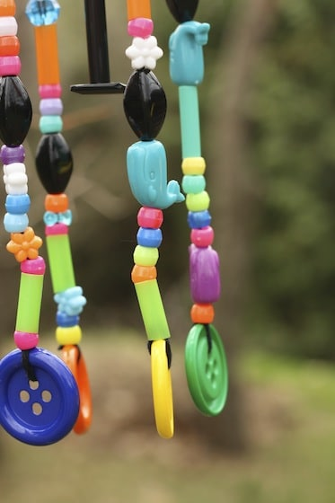 Close up of beads hanging from wind chime
