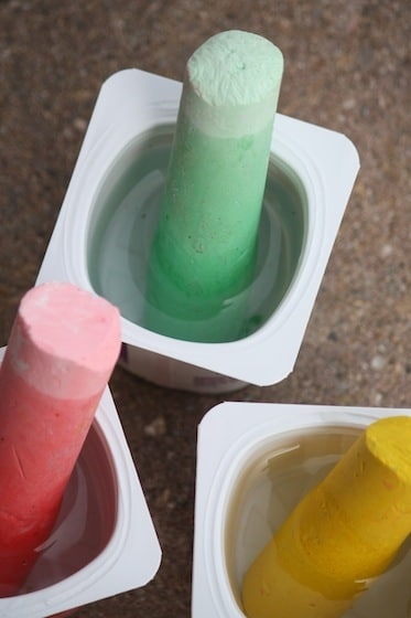 wet sidewalk chalk soaking in water