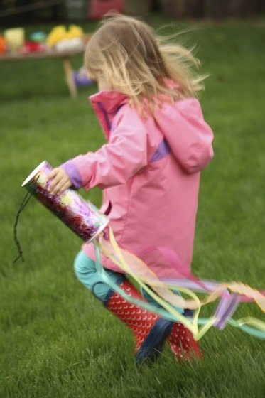 toddler running with windsock
