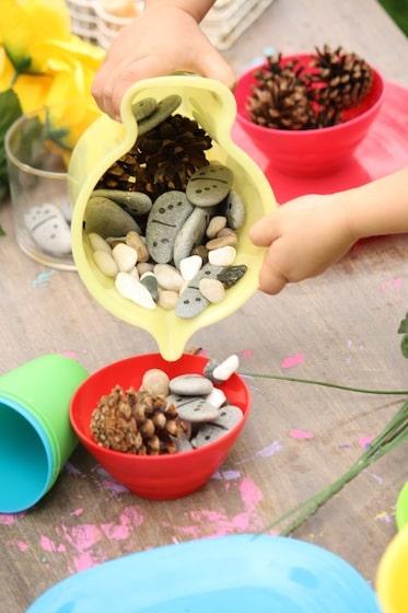 pouding stones into plastic bowl