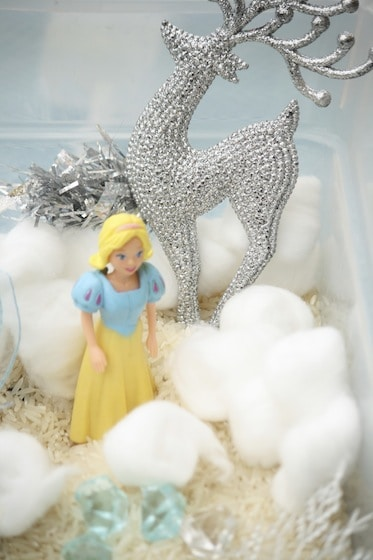 polly pocket as elsa for sensory bin