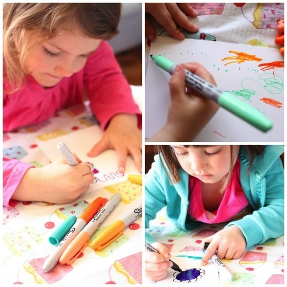 kids colouring with sharpies on photo paper