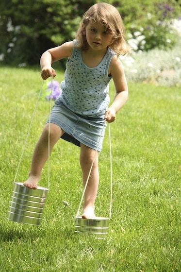 preschooler on homemade stilts