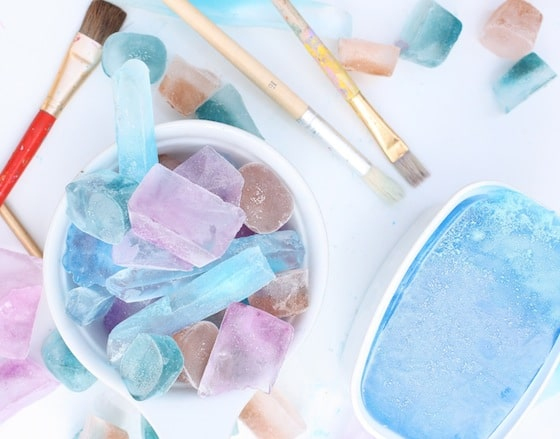 Coloured ice cubes, paint brushes for science activity with kids