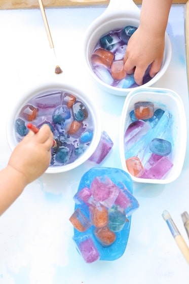 bowls of coloured ice cubes for a science activity for kids