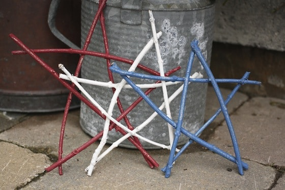 red white and blue stars against a rustic watering can