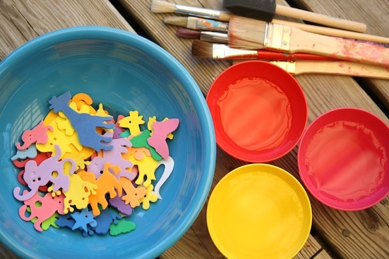 bowl of foam shapes, bowls of water and paintbrushes