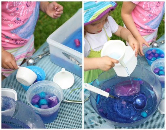 Kids scooping and pouring blue and purple water and ice