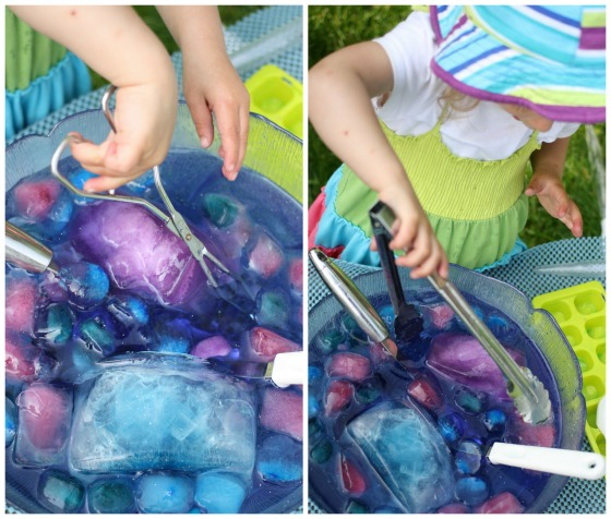 toddler using tongs to scoop purple and blue ice cubes