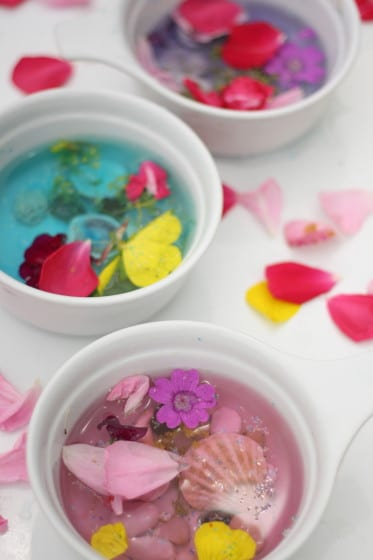 kids making fairy soup with water and flowers