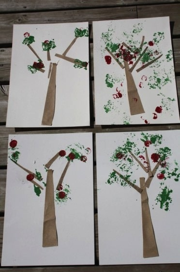 apple tree craft made with sandpaper, corks and aluminum foil