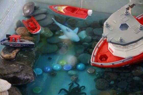 kids playing with sea water bin