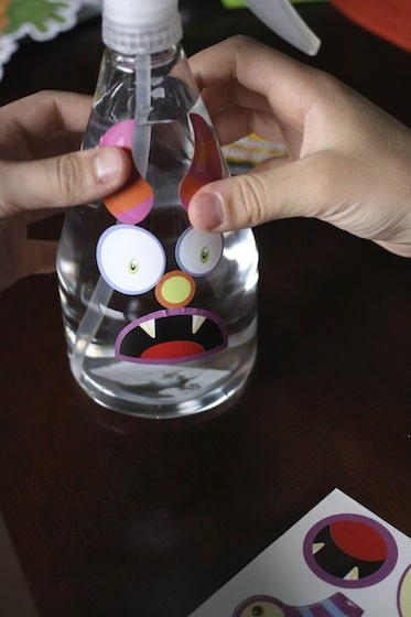 decorating a bottle of monster spray