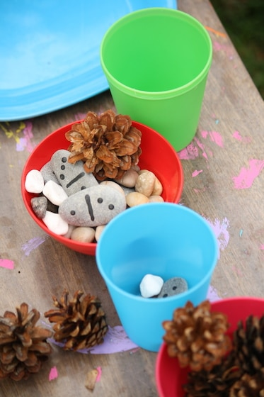 pretend tea party with stones, shells and pinecones