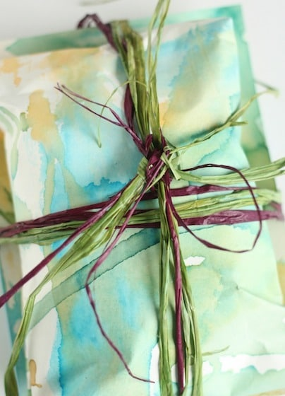 gift wrapped in homemade paper tied with raffia