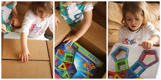 Toddlers opening a box of Magformers