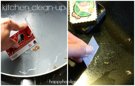 cleaning pan and glass top stove with credit card and razor