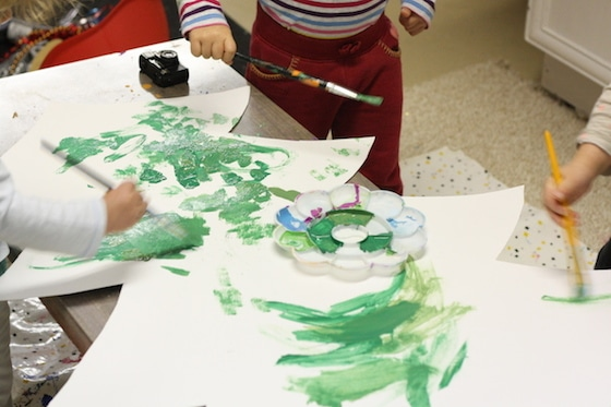 kids painting cardboard christmas tree