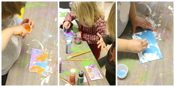 toddlers painting fridge magnets