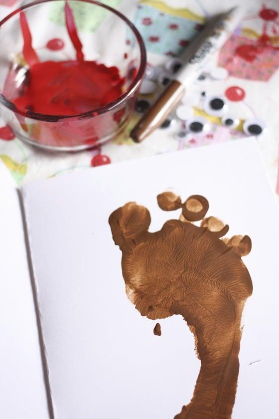 child's footprint for Rudolph footprint card