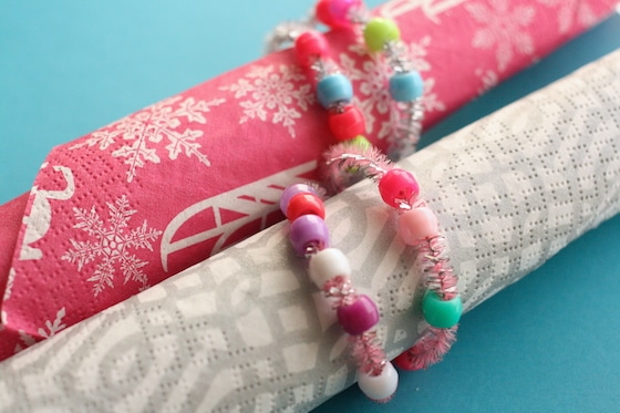 2 paper napkins in beaded pipe cleaner napkin rings