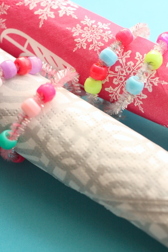 2 homemade holiday napkin rings made by toddlers