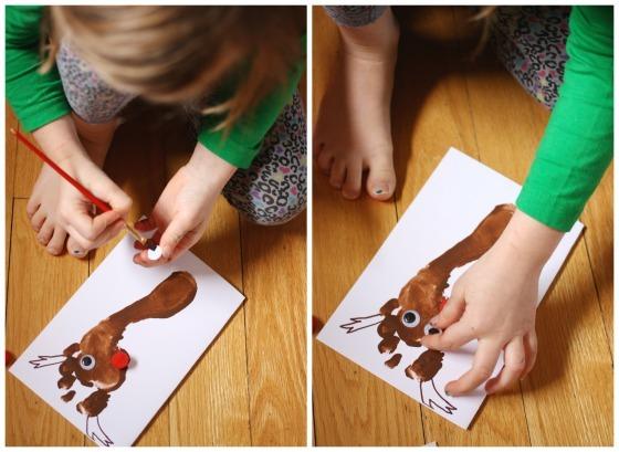 Child glueing googly eyes on reindeer footprint card