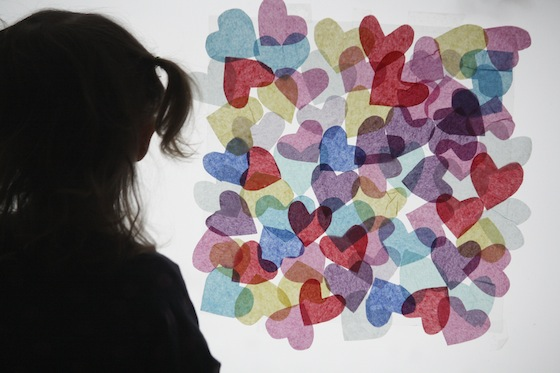 Window decorated with tissue paper hearts