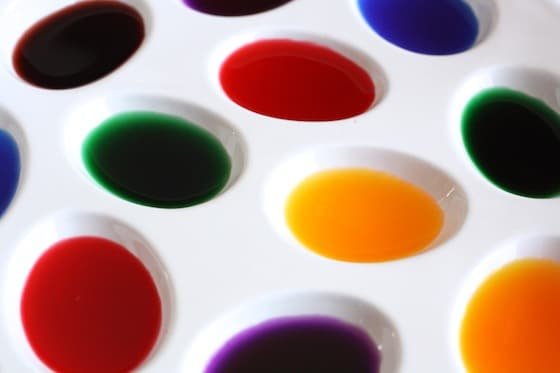 tray of homemade liquid watercolor paints