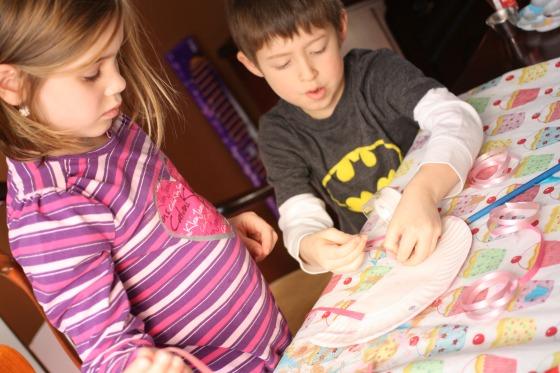 Kids making paper plate crafts