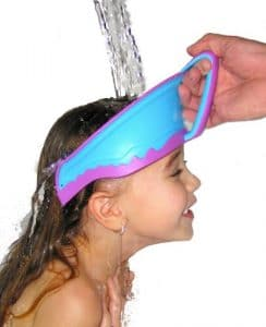 child wearing bath visor in tub