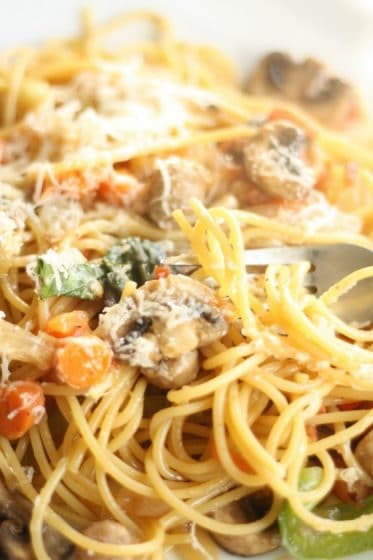 Close up spaghetti with mushroom, basil and parmesan cheese