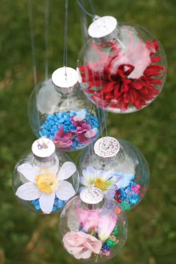 glass ornaments filled with coloured rocks and flowers