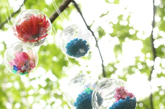Flower drop ornaments hanging in tree
