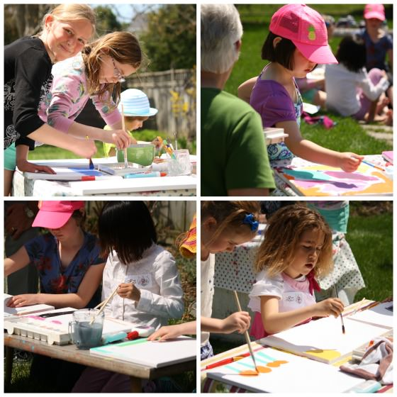 girls painting dollar store canvases at art party