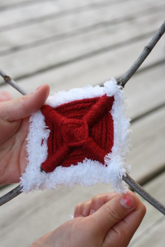 wrapping sticks with red and white yarn for Canada Day ornament