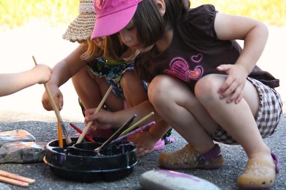 preschoolers painting rocks