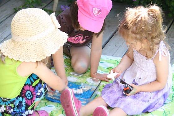 preschoolers playing with small world ocean bin
