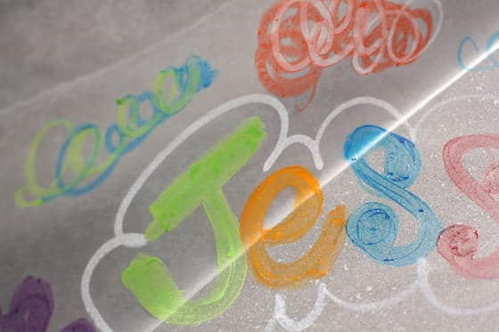 name drawn on hot baking sheet with melted crayons