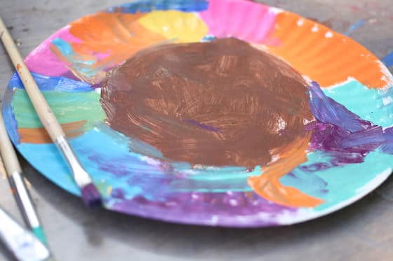 colourfully painted paper plate with brown center