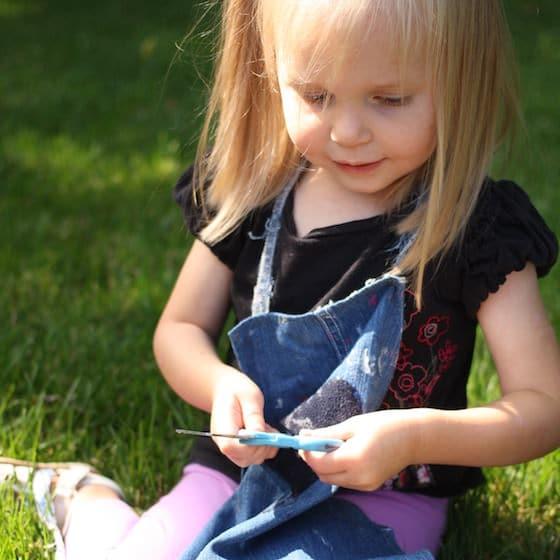 preschooler holding scissors