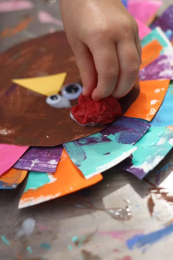 Adding a tissue paper wattle to the turkey craft