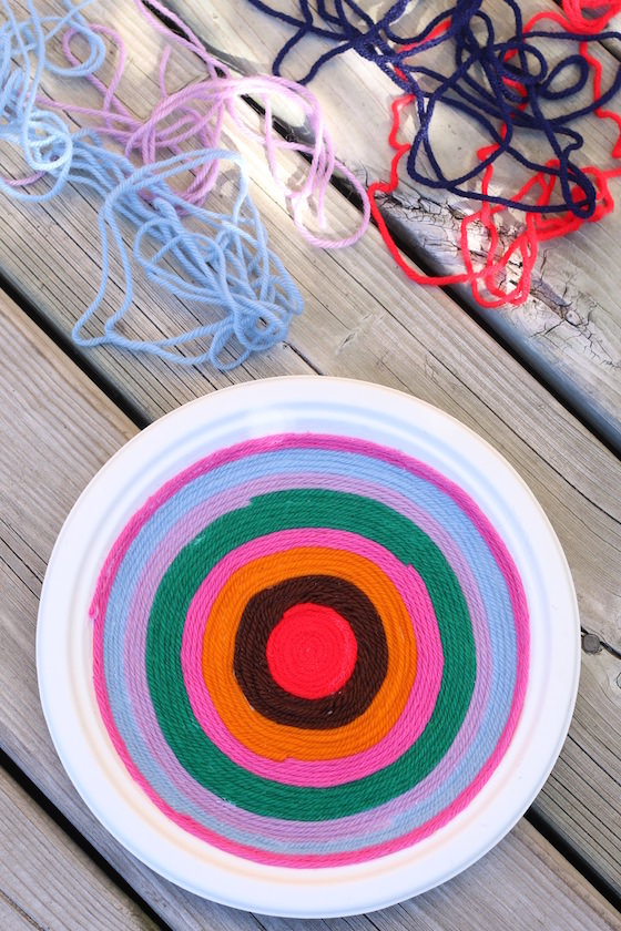 supplies for making yarn art on a paper plate