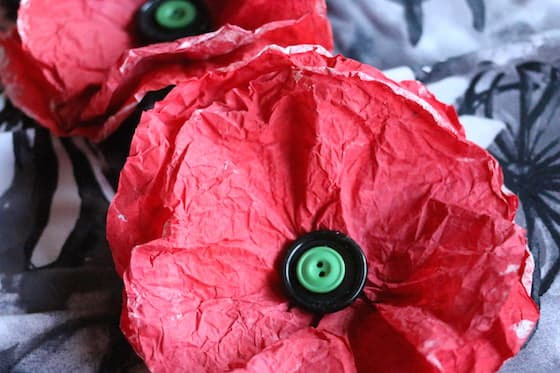 coffee filter poppies painted red with black button in center and green button on top