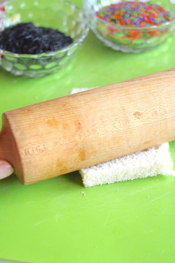 rolling bread flat with rolling pin