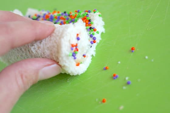 Rolling bread, butter and sprinkles into spirals