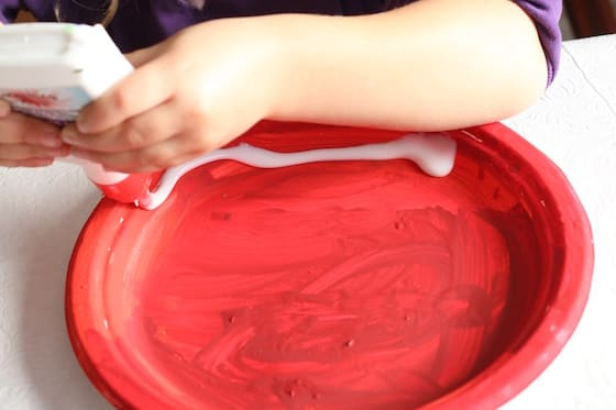 preschooler squeezing glue