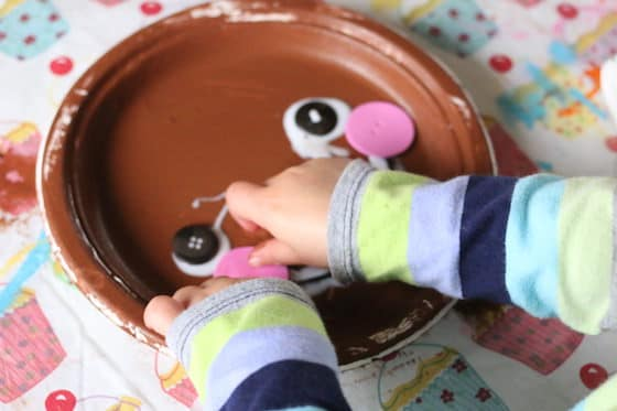 gluing face on gingerbread man craft